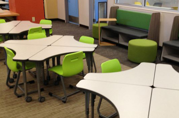 classroom desks, chairs arranged in circles