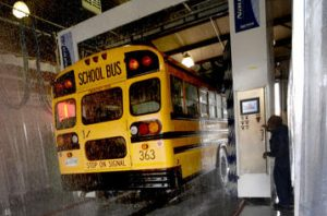 school bus driving into a washing station