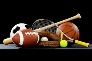 various sports equipment on black background